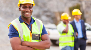 man smiling at construction site